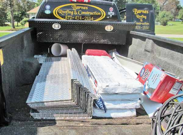 Stack of safety plates in the bed of a truck