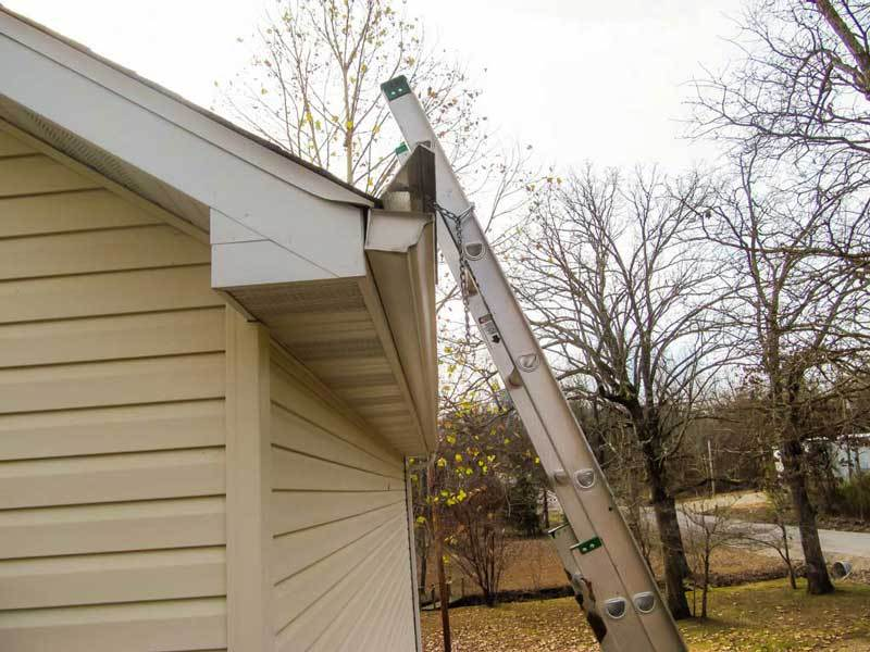 Ladder docked securely on the side of the house