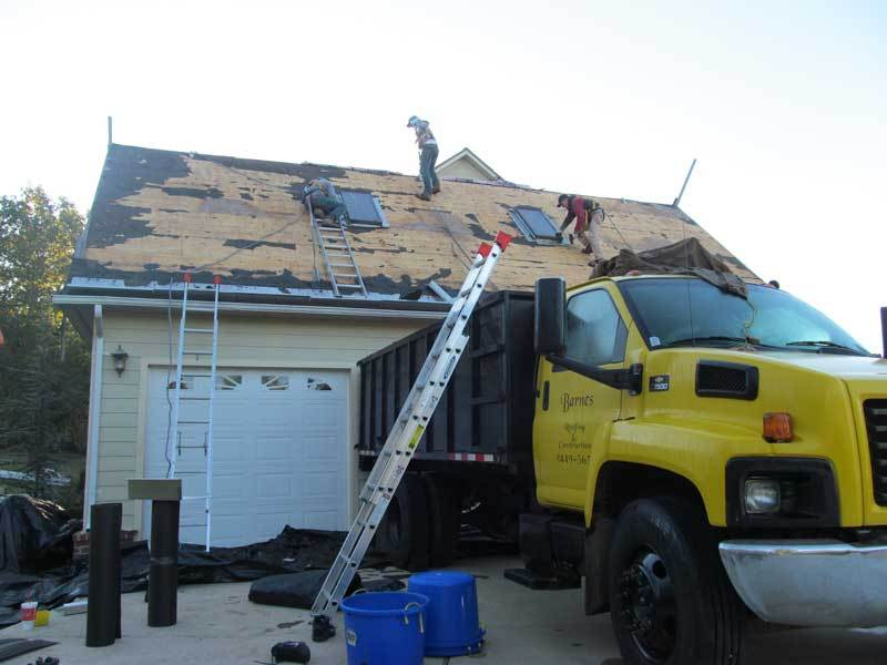 Workers almost completed tearing off all shingles