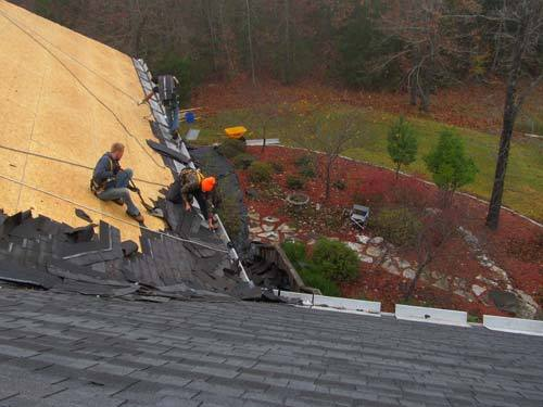Workers applying shingles