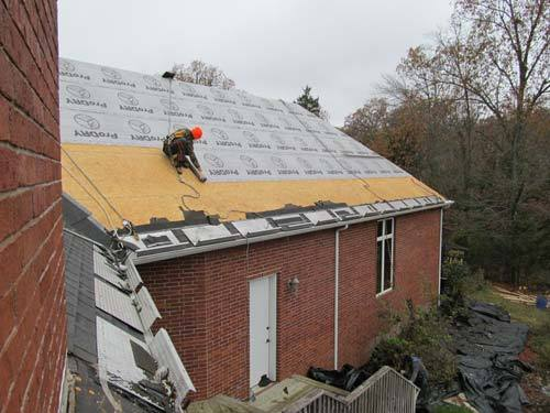 Worker on a steep slope on a roof